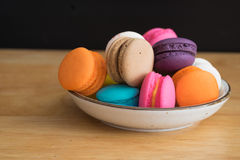 Colorful macaroon in ceramic plate Stock Photos