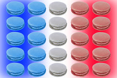 Colorful Macaroons. Assorment of macaroons arranged into French national flag Stock Photo