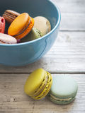 Colorful macaroons in blue bowl Royalty Free Stock Photo