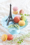 Colorful macaroons on blue plate Stock Photography