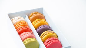 Colorful macaroons in the box on white background Stock Images
