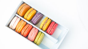 Colorful macaroons in the box on white background. Colorful macaroons in the box stock photos
