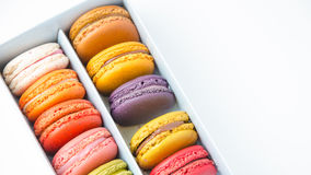 Colorful macaroons in the box on white background Royalty Free Stock Photos