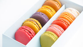 Colorful macaroons in the box on white background. Colorful macaroons in the box stock image