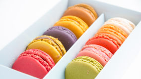 Colorful macaroons in the box on white background Royalty Free Stock Images