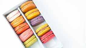 Colorful macaroons in the box on white background. Colorful macaroons in the box stock photography