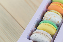 Colorful Macaroons boxset on wooden background. Colorful Macaroons boxset on wooden stock photo