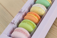 Colorful Macaroons boxset on wooden background. Colorful Macaroons boxset on wooden royalty free stock image