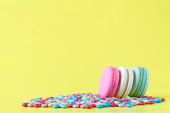 Colorful macaroons. On bright yellow background Royalty Free Stock Photography