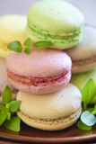 Colorful macaroons on brown plate Royalty Free Stock Images