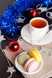 Colorful macaroons on Christmass tree background. Vertical Royalty Free Stock Photography