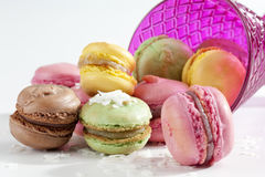 Colorful macaroons with coconut flakes and glass Royalty Free Stock Photos