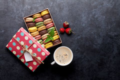Colorful macaroons and coffee Stock Photography
