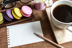 Colorful macaroons with coffee and blank note Royalty Free Stock Photography