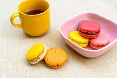 Colorful macaroons and coffee Stock Images