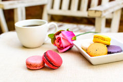 Colorful macaroons and coffee Stock Image