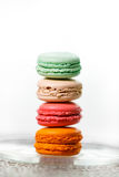 Colorful macaroons collection. Stack of four french macarons Royalty Free Stock Photos