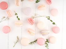 Colorful macaroons, Colorful french dessert, traditional french colorful macarons in a rows in a box Stock Photo