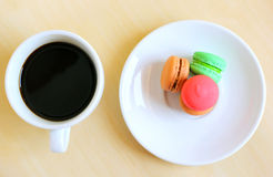 Colorful macaroons and cup of coffee Stock Photo