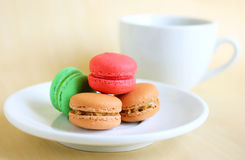 Colorful macaroons and cup of coffee Stock Photos