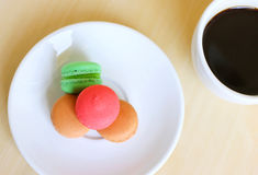 Colorful macaroons and cup of coffee Royalty Free Stock Photography