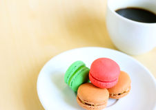 Colorful macaroons and cup of coffee Stock Images