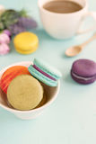 Colorful macaroons and a cup of coffee Stock Photos