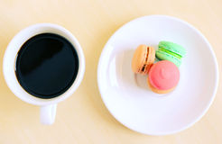 Colorful macaroons and cup of coffee Royalty Free Stock Images