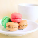 Colorful macaroons and cup of coffee with retro filter Royalty Free Stock Photos