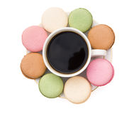 Colorful macaroons and cup of coffee shaped like flower with clipping path Royalty Free Stock Image
