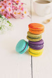 Colorful macaroons and a cup of coffee Stock Images