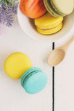Colorful macaroons and a cup of coffee Stock Photography
