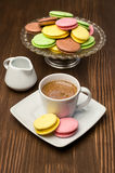 Colorful macaroons and cup with coffee Stock Image