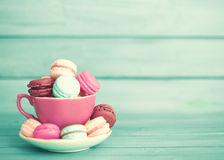 Colorful macaroons in a cup Stock Image