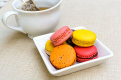 Colorful macaroons and a cup of tea Royalty Free Stock Images