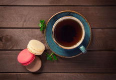 Colorful macaroons with cup of tea Stock Photography