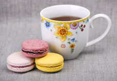 Colorful macaroons with cup of tea Royalty Free Stock Photography