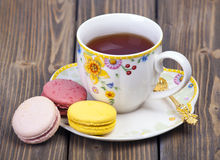 Colorful macaroons with cup of tea Royalty Free Stock Photos