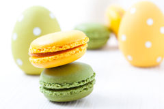 Colorful macaroons and Easter eggs Stock Photography