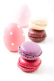 Colorful macaroons and Easter eggs Royalty Free Stock Image