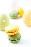 Colorful macaroons and Easter eggs Stock Image