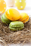 Colorful macaroons and Easter eggs Stock Images