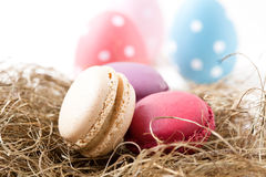 Colorful macaroons and Easter eggs Stock Photo