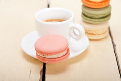 Colorful macaroons with espresso coffee. Over white wood table Stock Images