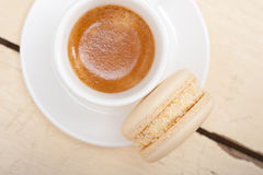 Colorful macaroons with espresso coffee. Over white wood table Stock Photography
