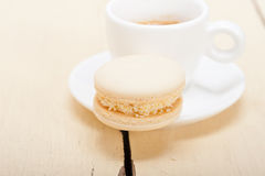 Colorful macaroons with espresso coffee. Over white wood table Royalty Free Stock Photography