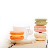 Colorful macaroons with espresso coffee. Over white wood table Stock Photo