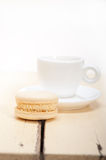 Colorful macaroons with espresso coffee. Over white wood table Royalty Free Stock Image