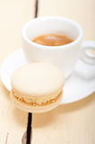 Colorful macaroons with espresso coffee. Over white wood table Royalty Free Stock Photos