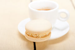 Colorful macaroons with espresso coffee. Over white wood table Royalty Free Stock Photo